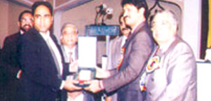 Receiving Participation Award from Provincial Housing Minister